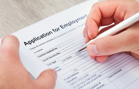 Photo of a person filling out an employment application